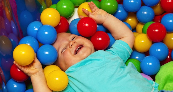 baby with play balls